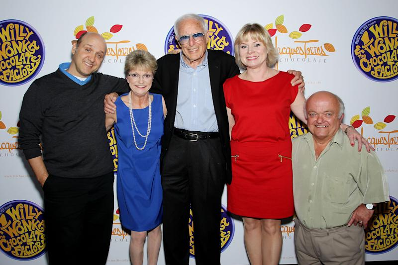 """FILE - This Oct. 18, 2011 file photo originally released by Starpix shows the cast and director from the 1971 film, """"Willy Wonka & The Chocolate Factory,"""" from left, Paris Themmen, who portrayed Mike Teevee, Denise Nickerson, who portrayed Violet Beauregarde, director Mel Stuart, Julie Cole, who portrayed Veruca Salt, and Rusty Goffe, who played the cart-wheeling Oompa-Loompa, posing at Jacques Torres Chocolates during an event promoting the 40th anniversary of the popular children's film and the Warner Home Video Ultimate Collector's Edition Blu-ray and DVD launch in New York. Stuart died Thursday, Aug. 9, 2012 of cancer at his home in Beverly Hills, Calif. He was 83. (AP Photo/StarPix, Marion Curtis, file)"""