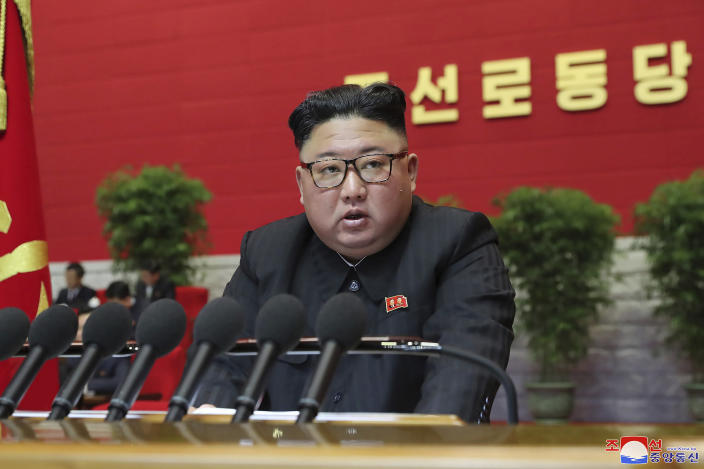 """In this photo provided by the North Korean government, North Korean leader Kim Jong Un attends a ruling party congress in Pyongyang, North Korea Thursday, Jan. 7, 2021. Kim has reviewed relations with rival South Korea and underscored the need to drastically improve its ties with the outside world as he addressed a major political conference for the third consecutive day, state media reported Friday. Independent journalists were not given access to cover the event depicted in this image distributed by the North Korean government. The content of this image is as provided and cannot be independently verified. Korean language watermark on image as provided by source reads: """"KCNA"""" which is the abbreviation for Korean Central News Agency. (Korean Central News Agency/Korea News Service via AP)"""