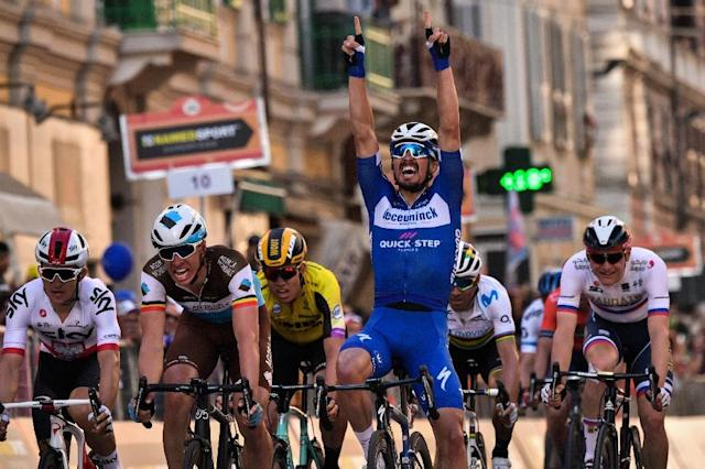 France's Julian Alaphilippe celebrates his first victory in a 'Monument' one-day classic race at the Milan-San Remo. (AFP Photo/Marco BERTORELLO)