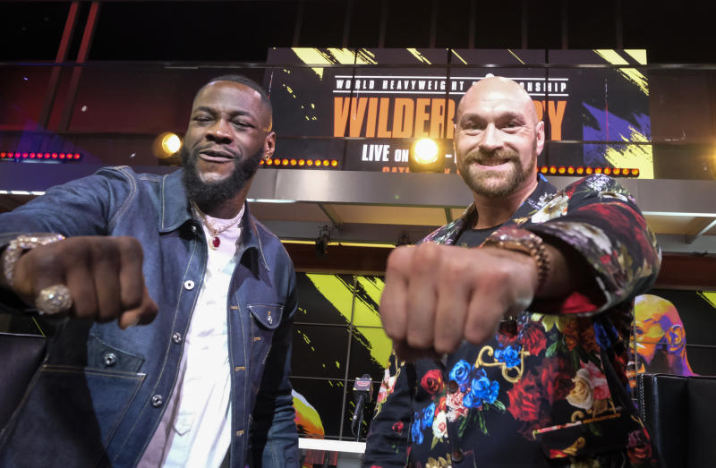 Boxers Deontay Wilder (L) and Tyson Fury (R) face-off during a press conference in Los Angeles, California on January 25, 2020, ahead of their re-match fight in Las Vegas on February 22. (Photo by RINGO CHIU / AFP) (Photo by RINGO CHIU/AFP via Getty Images)