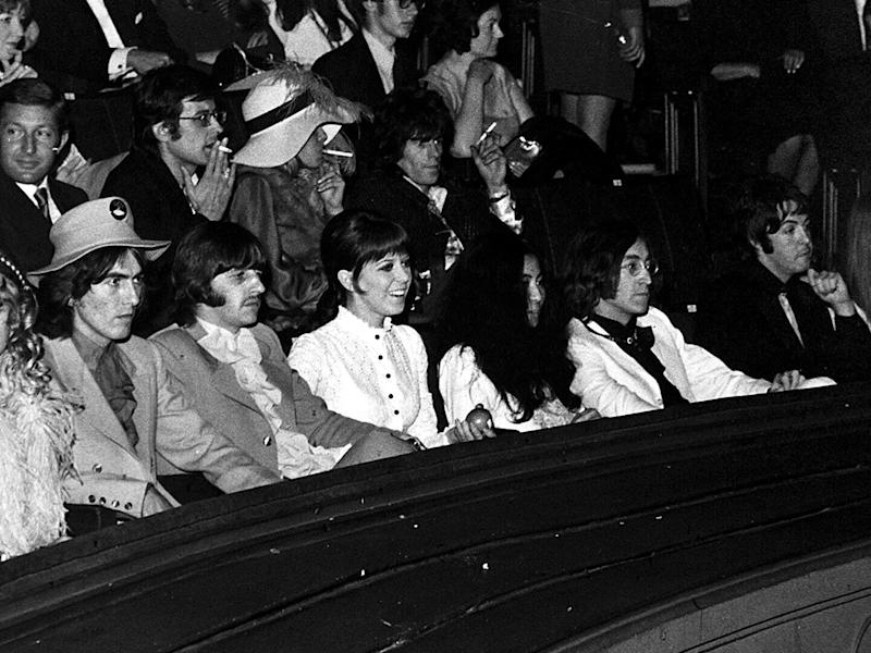 The writing on the wall: George Harrison, Ringo Starr and wife Maureen, Yoko Ono, John Lennon and Paul McCartney at the 1968 premiere of 'Yellow Submarine': Harry Myers/Rex