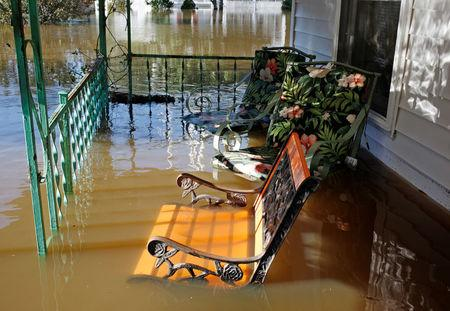 Flood waters from the swollen Tar River rise into a residential porch in the aftermath of Hurricane Matthew, in Tarboro, North Carolina on October 13, 2016.   REUTERS/Jonathan Drake