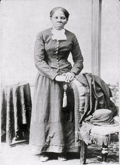 Harriet Tubman poses for a picture taking in the 19th century.