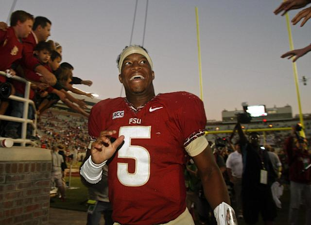 Florida State quarterback Jameis Winston (5) reacts to fans as he leaves Doak Campbell stadium after an NCAA college football game against North Carolina State, Saturday, Oct. 26, 2013, in Tallahassee, Fla. Florida State won 49-17. (AP Photo/Phil Sears)