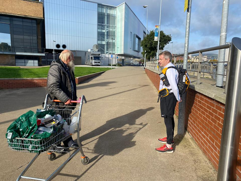 Michael Ferndale stops to talk to a well-wisher on day two in Belfast after supporters heard his talkSPORT interview on Friday