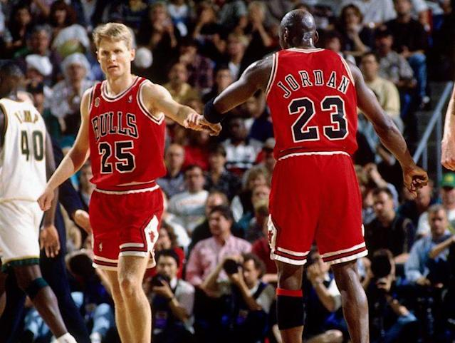 "<a class=""link rapid-noclick-resp"" href=""/ncaaf/players/263612/"" data-ylk=""slk:Michael Jordan"">Michael Jordan</a> high fives teammate Steve Kerr during Game 3 of the 1996 NBA Finals. (Getty)"