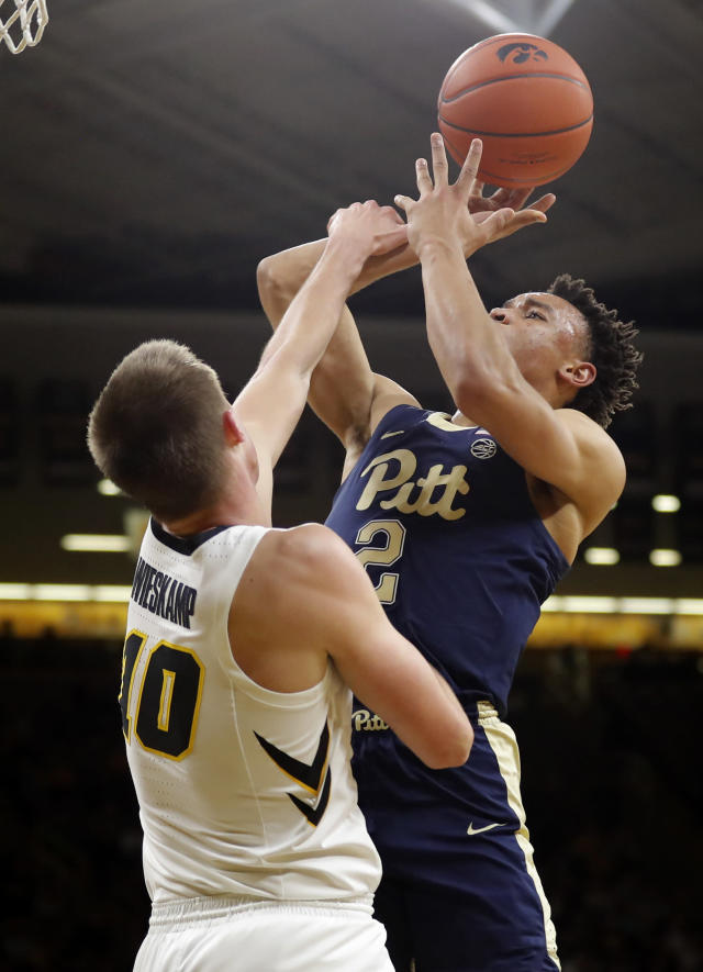 Pittsburgh guard Trey McGowens (2) is fouled by Iowa guard Joe Wieskamp while driving to the basket during the first half of an NCAA college basketball game, Tuesday, Nov. 27, 2018, in Iowa City, Iowa. (AP Photo/Charlie Neibergall)