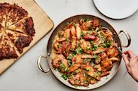 """One large potato pancake sliced into wedges is an easy large-format alternative to making individual latkes. Serve them alongside applesauce-braised chicken thighs for a holiday dinner. <a href=""""https://www.epicurious.com/recipes/food/views/hanukkah-chicken?mbid=synd_yahoo_rss"""" rel=""""nofollow noopener"""" target=""""_blank"""" data-ylk=""""slk:See recipe."""" class=""""link rapid-noclick-resp"""">See recipe.</a>"""