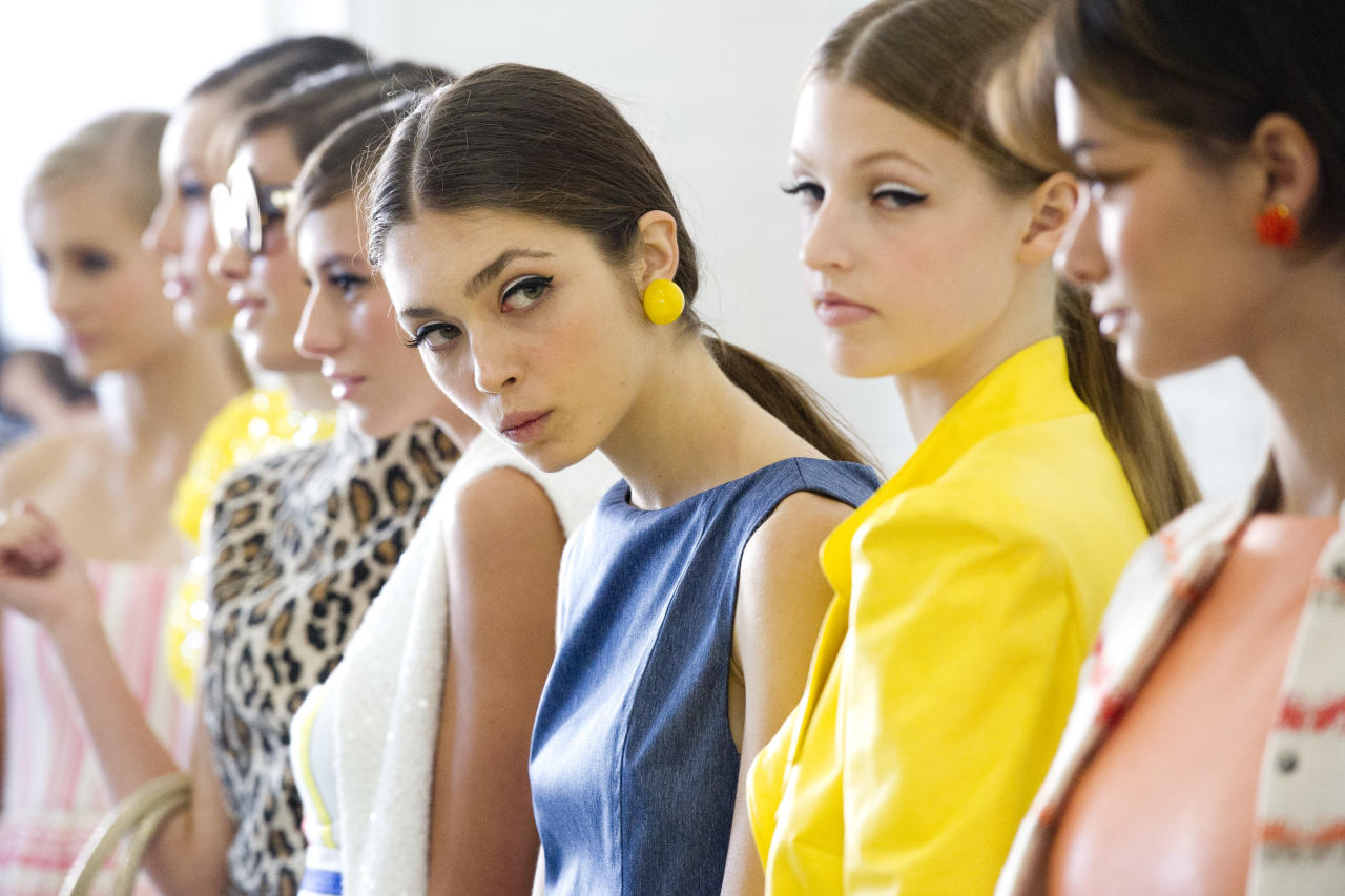 Models line up backstage at the alice + olivia by Stacey Bendet Spring 2013 show during Fashion Week in New York on Monday, Sept. 10, 2012. (Photo by Charles Sykes/Invision/AP)