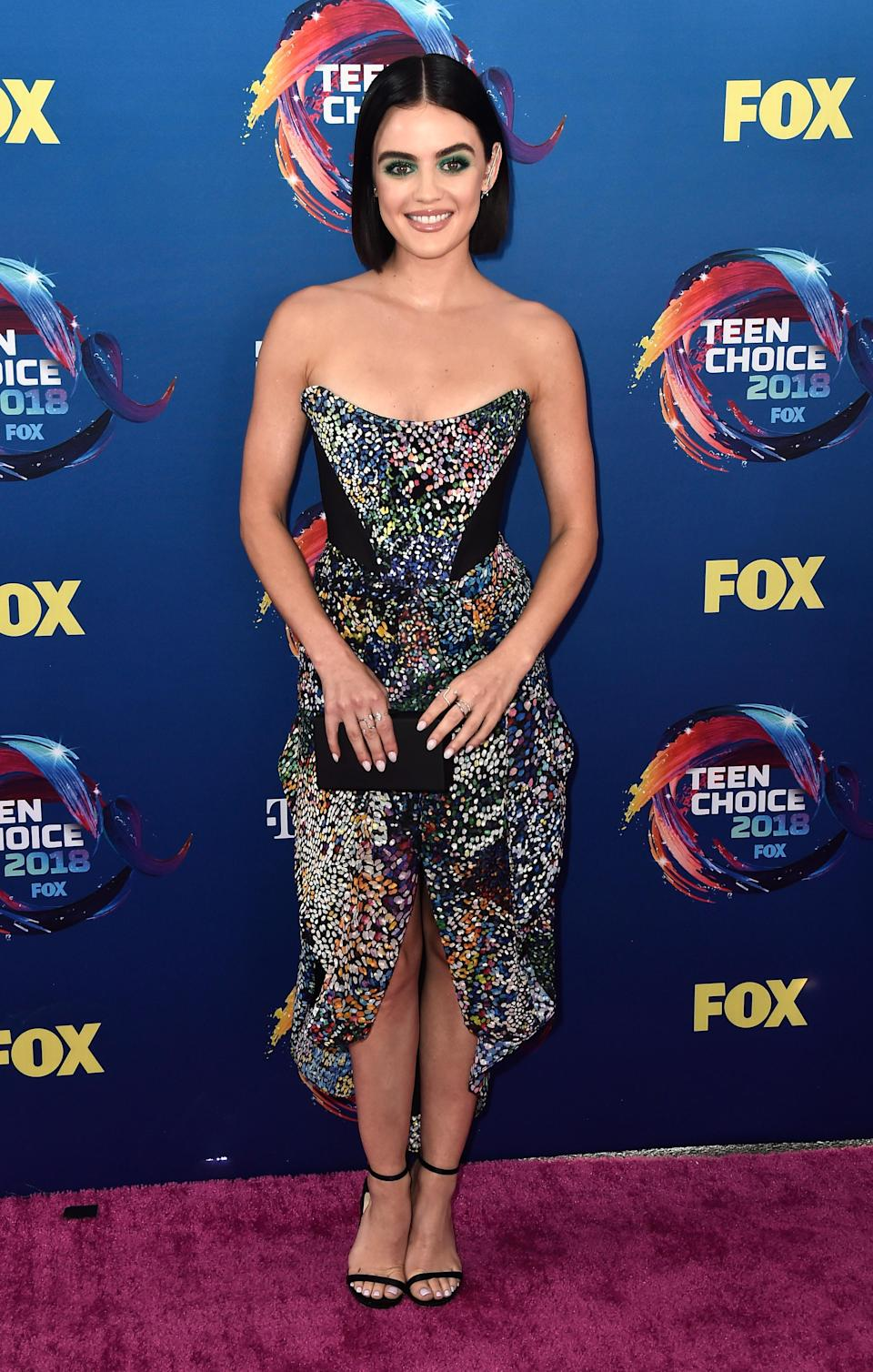 <p>Clad in a strapless Mary Katranzou dress, the former 'Pretty Little Liars' star finished her look with statement green eyeshadow. <em>[Photo: Getty]</em> </p>