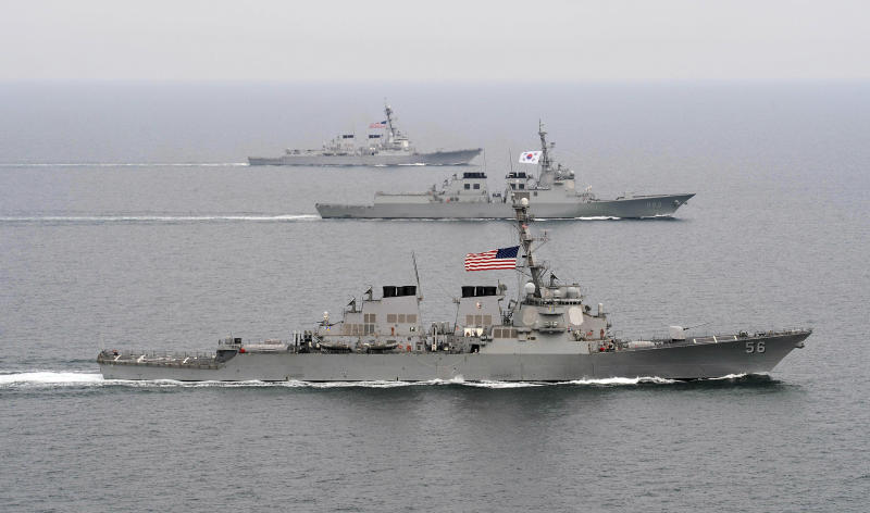 In this March 17, 2013 photo released by the U.S. Navy, the Arleigh Burke-class guided-missile destroyer USS John S. McCain, foreground, the Republic of Korea Navy Aegis-class destroyer ROKS Seoae-Yu-Seong-Ryong, center, and the Arleigh Burke-class guided-missile destroyer USS McCampbell move into formation during exercise Foal Eagle 2013 in the West Sea in South Korea. (AP Photo/U.S. Navy, Mass Communication Specialist 3rd Class Declan Barnes)