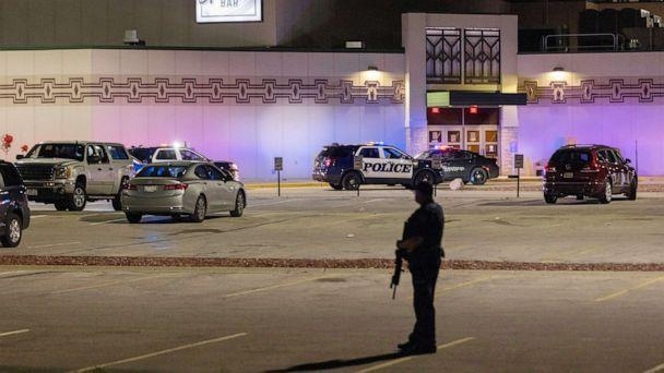 PHOTO: Police stand guard in the parking area outside the Oneida Casino in the early morning hours, May 2, 2021, near Green Bay, Wis., following a shooting that left three dead and seriously wounded another. (Mike Roemer/AP)