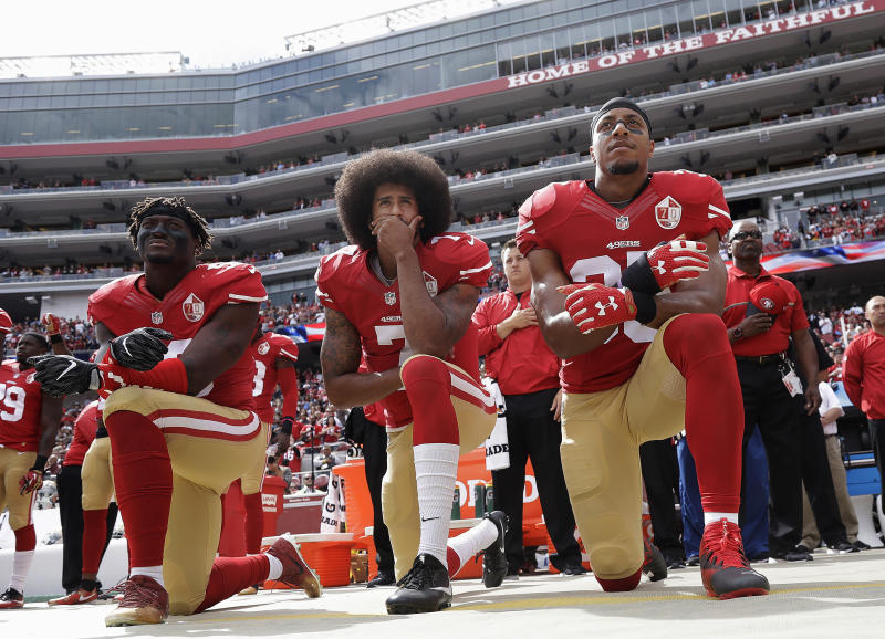 In this Oct. 2, 2016, file photo, San Francisco 49ers outside linebacker Eli Harold, left, quarterback Colin Kaepernick, center, and safety Eric Reid kneel during the national anthem. (AP)