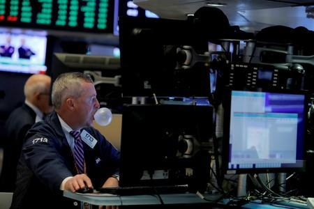 A trader works on the trading floor at the New York Stock Exchange (NYSE) at the opening of the market in New York City