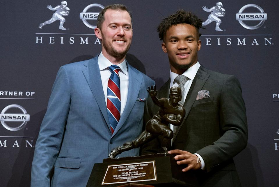 FILE - In this Dec. 8, 2018, file photo, Oklahoma football coach Lincoln Riley, left, poses with Oklahoma quarterback Kyler Murray, winner of the Heisman Trophy, in New York. Oklahoma coach Lincoln Riley has been to the College Football Playoff twice and coached two Heisman winners since taking over as Oklahoma's coach 18 months ago. With all that success already at age 35, the school will have to battle to hold NFL teams at bay.(AP Photo/Craig Ruttle, File)