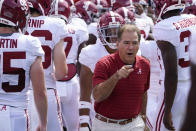 Alabama head coach Nick Saban, center, leads his team on the field during warm ups before an NCAA college football game against Florida, Saturday, Sept. 18, 2021, in Gainesville, Fla. (AP Photo/John Raoux)