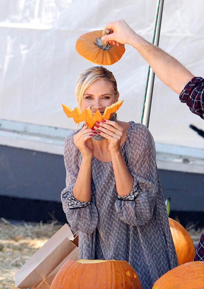 Sorry, Heidi Klum, we still know it's you! The mom of four donned Jack-O-Lantern accessories at Mr. Bones Pumpkin Patch in Los Angeles on Wednesday.   INFDaily.com - October 12, 2011