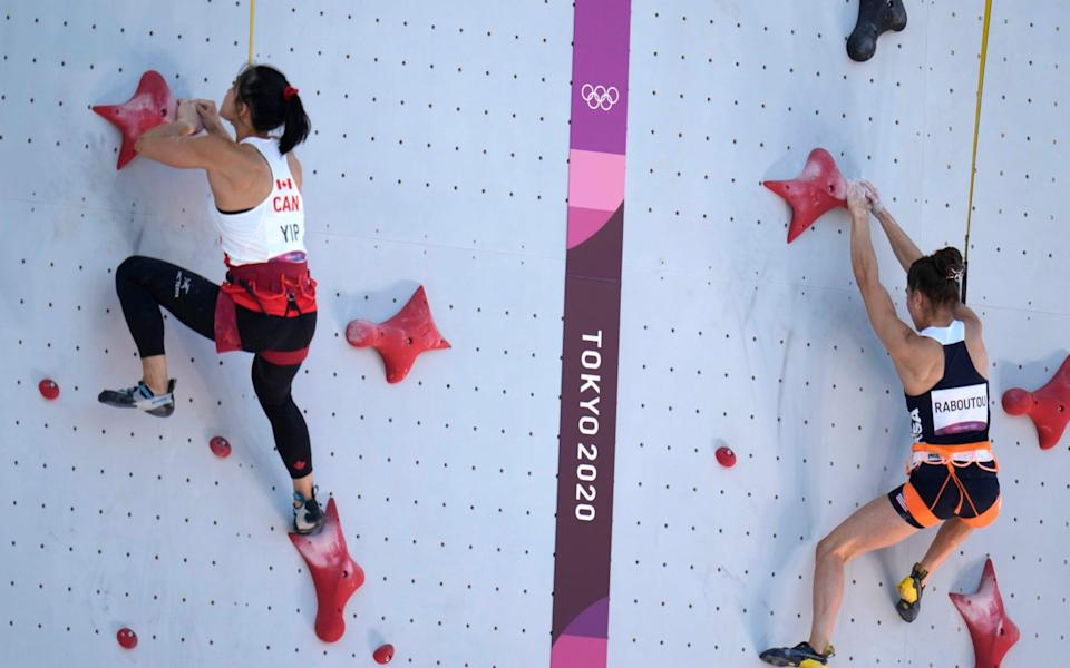 Alannah Yip, of Canada, right, races against Brooke Raboutou, of the United States, during the speed qualification portion of the women's sport - AP
