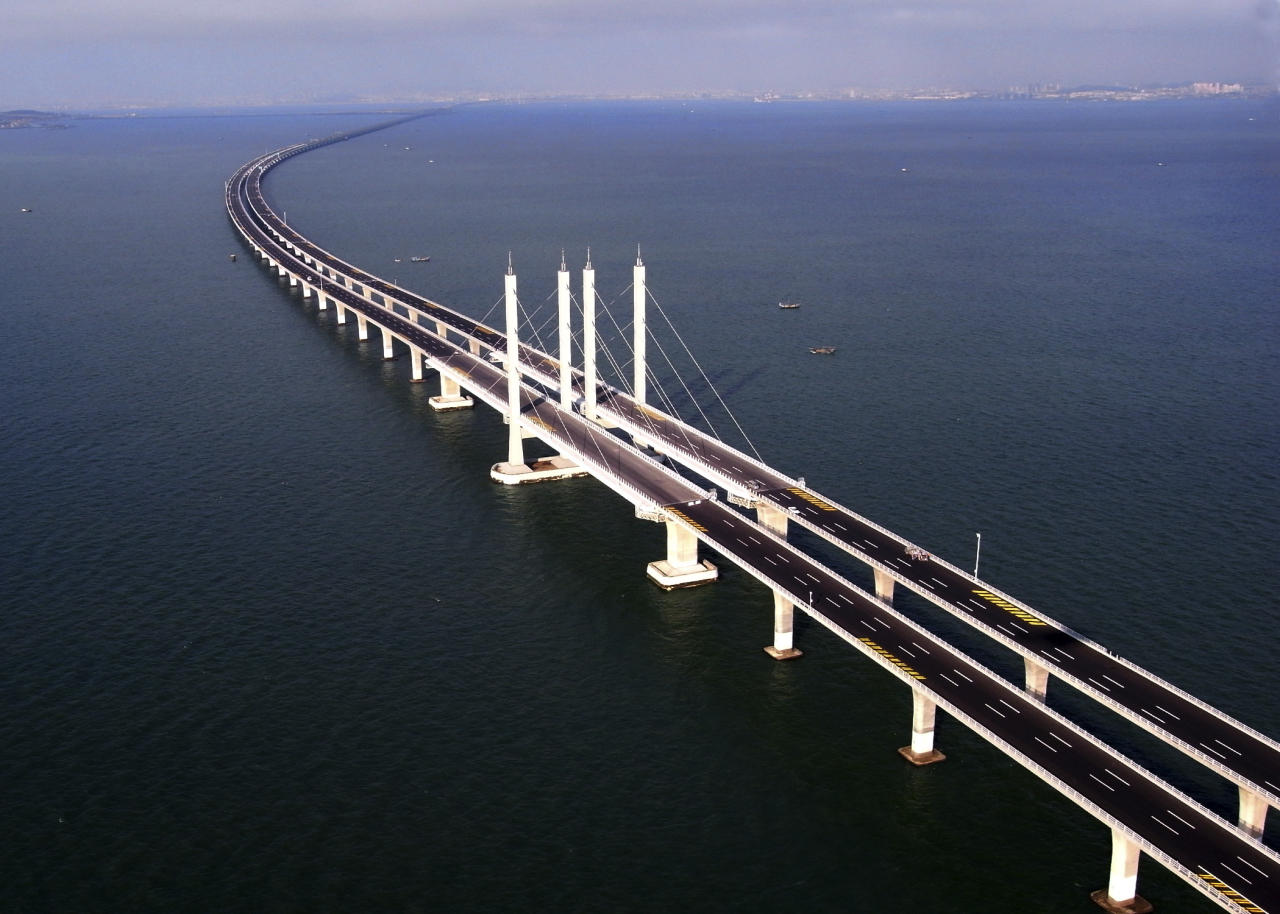 This photo taken Tuesday, June 21, 2011 released by China's Xinhua news agency shows the Jiaozhou Bay Bridge in Qingdao, east China's Shandong Province. China opened Thursday, June 30, 2011, the world's longest cross-sea bridge, which is 42 kilometers (26 miles) long and links China's eastern port city of Qingdao to an offshore island, Huangdao. (AP Photo/Xinhua, Yan Runbo) NO SALES