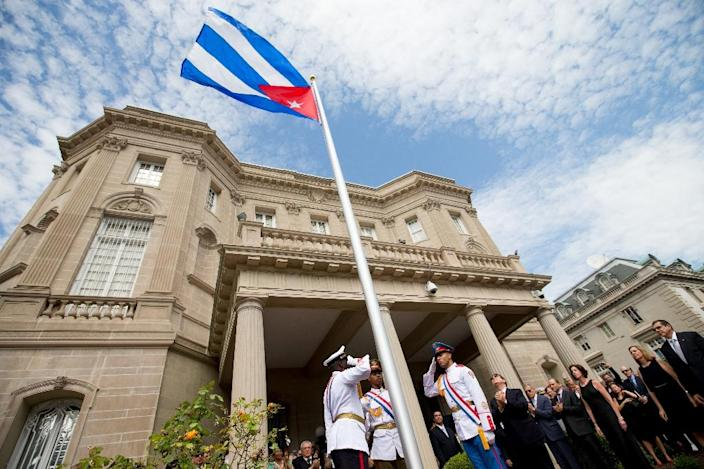 Cuban Foreign Minister Bruno Rodriguez raises the Cuban flag over the country's new embassy in Washington on July 20, 2015 (AFP Photo/Andrew Harnik)