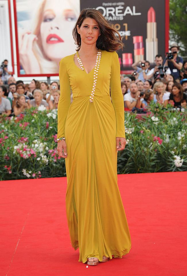 "Perfectly draped in her Marios Schwab marigold-yellow dress, Marisa Tomei is the epitome of style and glamor at the Venice Film Festival premiere of ""The Ides of March"" on August 31, 2011."