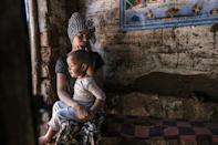 In the shadows: An Eritrean woman and her child at the Mai Aini refugee camp in northern Ethiopia