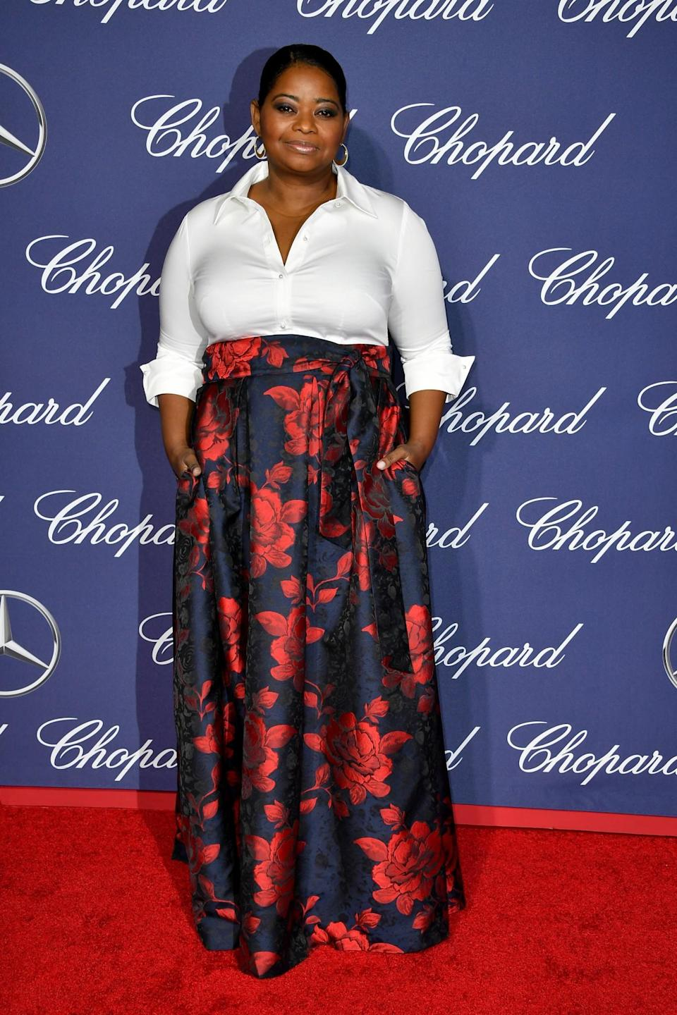 <p>Octavia stood out in a bold floral skirt, which she paired with a white blouse. [Photo: Getty] </p>
