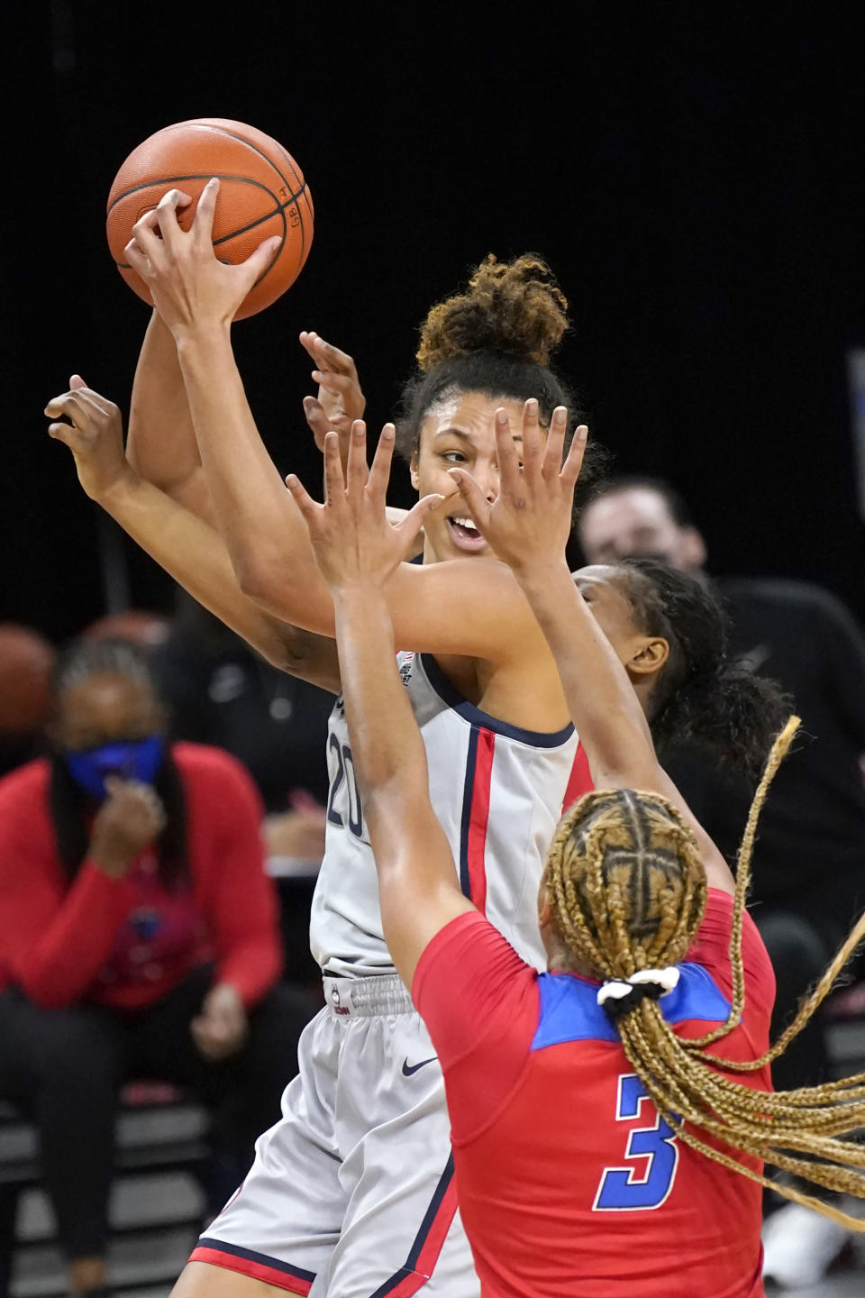 Connecticut's Olivia Nelson-Ododa is pressured by DePaul's Deja Church (3) and Darrione Rogers during the first half of an NCAA college basketball game Sunday, Jan. 31, 2021, in Chicago. (AP Photo/Charles Rex Arbogast)