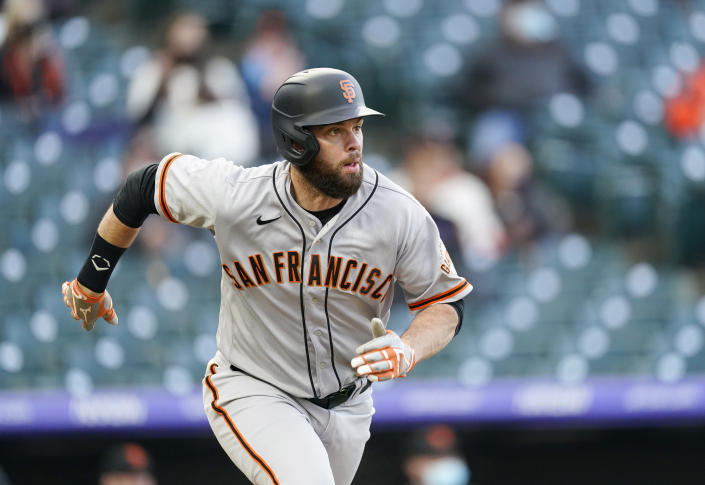 San Francisco Giants' Brandon Belt follows the flight of his two-run home run as he heads up the first-base line against the Colorado Rockies in the first inning of game two of a baseball doubleheader Tuesday, May 4, 2021, in Denver. (AP Photo/David Zalubowski)