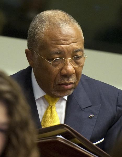 Former Liberian President Charles Taylor waits for the start of his sentencing judgement in the courtroom of the Special Court for Sierra Leone(SCSL) in Leidschendam, near The Hague, Netherlands, Wednesday May 30, 2012. The SCSL found Taylor guilty last month on 11 charges of aiding and abetting the rebels who went on a bloody rampage during the decade-long war that ended in 2002 with more than 50,000 dead. Taylor became the first former head of state convicted by an international war crimes court since World War II. Taylor will serve his sentence in a British prison. (AP Photo/Toussaint Kluiters, Pool)