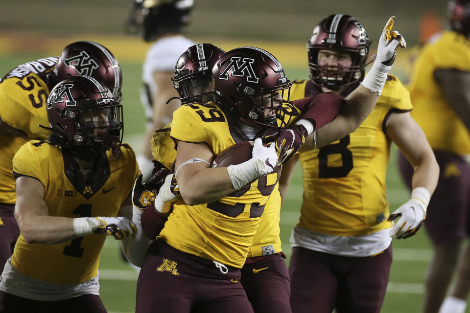 Minnesota linebacker Josh Aune (29) holds the ball after he intercepted a Purdue pass during the second half of an NCAA college football game Friday, Nov. 20, 2020, in Minneapolis. Minnesota won 34-31. (AP Photo/Stacy Bengs)