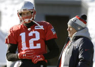 FILE - New England Patriots quarterback Tom Brady, left, stands with head coach Bill Belichick, right, during an NFL football practice, Thursday, Jan. 18, 2018, in Foxborough, Mass. Without Bill Belichick, Tom Brady won his seventh Super Bowl and is on pace to throw a career-high 53 touchdown passes at age 44. Without Brady under center, Belichick is 54-61 over his career, including 8-11 since the future Hall of Fame quarterback left New England for Tampa Bay. (AP Photo/Steven Senne, file)