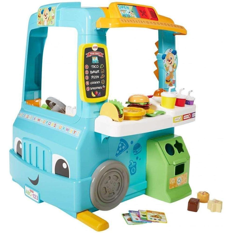 """<p><strong>Fisher-Price</strong></p><p>walmart.com</p><p><strong>$49.97</strong></p><p><a href=""""https://go.redirectingat.com?id=74968X1596630&url=https%3A%2F%2Fwww.walmart.com%2Fip%2F55734322&sref=https%3A%2F%2Fwww.bestproducts.com%2Flifestyle%2Fg34726670%2Fplay-kitchens-for-kids%2F"""" rel=""""nofollow noopener"""" target=""""_blank"""" data-ylk=""""slk:Shop Now"""" class=""""link rapid-noclick-resp"""">Shop Now</a></p><p>Order up! Teach your toddler how to run a successful food truck with this adorable play kitchen. They will spend hours greeting customers, taking orders, and serving up pretend pizza, tacos, and hamburgers (all included). The light-up service bell is a clever touch.</p>"""