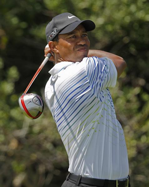 Tiger Woods watches his drive from the second tee during the third round of the PGA Championship golf tournament on the Ocean Course of the Kiawah Island Golf Resort in Kiawah Island, S.C., Saturday, Aug. 11, 2012. (AP Photo/Lynne Sladky)
