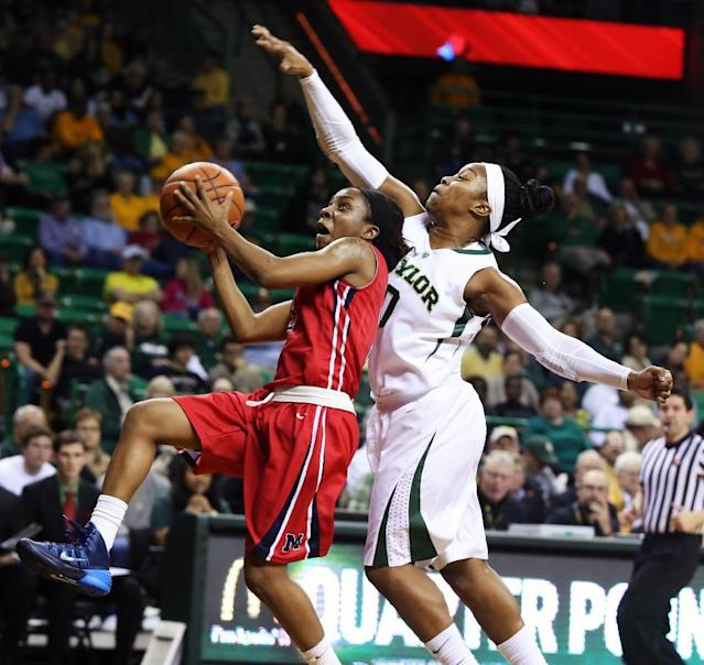 Mississippi's Valencia McFarland, left, drives past Baylor guard Odyssey Sims during the first half of an NCAA college basketball game, Wednesday, Dec. 18, 2013, in Waco, Texas. (AP Photo/Waco Tribune Herald, Rod Aydelotte)