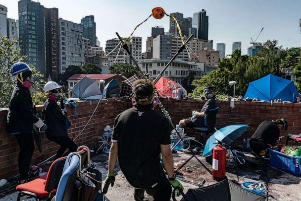 PHOTO: Demonstrators use a catapult to fire a brick at the Hong Kong Polytechnic University, Nov. 17, 2019, in Hong Kong. (Anthony Kwan/Getty Images)
