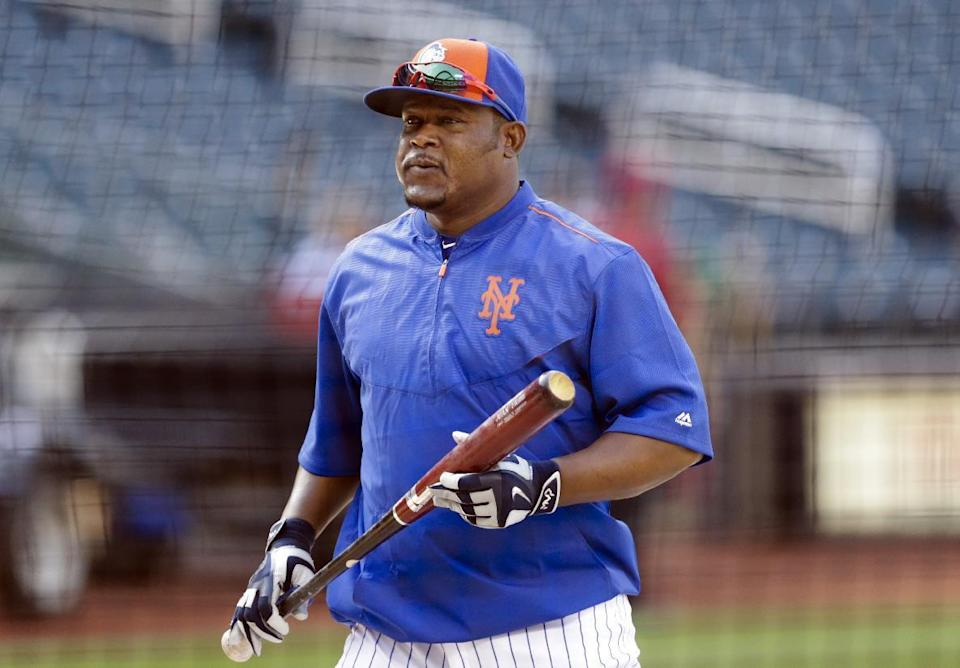 New York Mets' Juan Uribe takes part in batting practice before a baseball game against the Los Angeles Dodgers, Saturday, July 25, 2015, in New York. (AP Photo/Frank Franklin II)