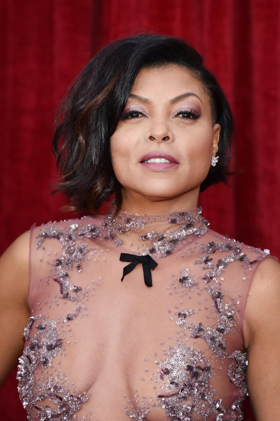 <p>We were obsessed with Taraji's co-ordinated dusty pink eyeshadow and lipstick, which perfectly matched her equally stunning adorned dress. [Photo: Getty] </p>
