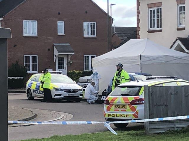 Police cordoned off the street and erected two tents at adjacent properties (Rod Minchin/PA)