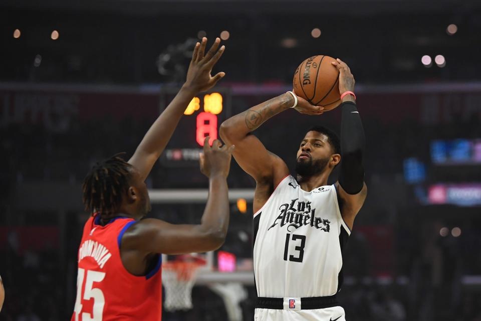 Los Angeles Clippers forward Paul George, right, shoots as Detroit Pistons forward Sekou Doumbouya defends during the first half of an NBA basketball game Thursday, Jan. 2, 2020, in Los Angeles. (AP Photo/Mark J. Terrill)