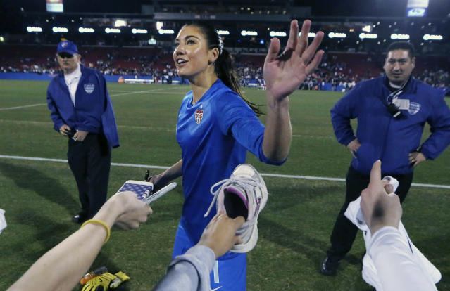 U.S. goalkeeper Hope Solo (1) waves to fans after a soccer game against Canada, Friday, Jan. 31, 2014, in Frisco, Texas. The U.S. won 1-0. (AP Photo/LM Otero)