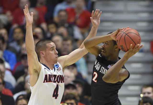 San Diego State guard Xavier Thames (2) looks to pass around Arizona guard T.J. McConnell (4) during the first half in a regional semifinal of the NCAA men's college basketball tournament, Thursday, March 27, 2014, in Anaheim, Calif. (AP Photo/Mark J. Terrill)