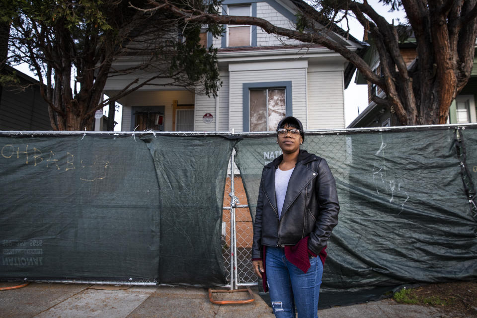 Moms 4 Housing activist Misty Cross stands for a portrait in front of the now fenced off vacant home that she and other homeless or insecurely housed mothers occupied during a months-long protest which ended in a court ordered eviction, in Oakland, California on January 28, 2020. - When Dominique Walker moved back from Mississippi to her native California last year, she planned to pursue a nursing degree while caring for her two small children. But she and other moms and their children ended up living as squatters in a bold, high-profile protest against homelessness. According to city officials, an estimated 4,071 people were living on the street, in shelters or in their cars in 2019 in Oakland, a 47 percent increase in two years. (Photo by Philip Pacheco / AFP) (Photo by PHILIP PACHECO/AFP via Getty Images)
