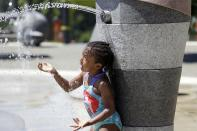 Mellena O'Brien, 4, plays in the Yesler TerraceSpray Park during a heat wave hitting the Pacific Northwest, Sunday, June 27, 2021, in Seattle. Yesterday set a record high for the day with more record highs expected today and Monday. (AP Photo/John Froschauer)