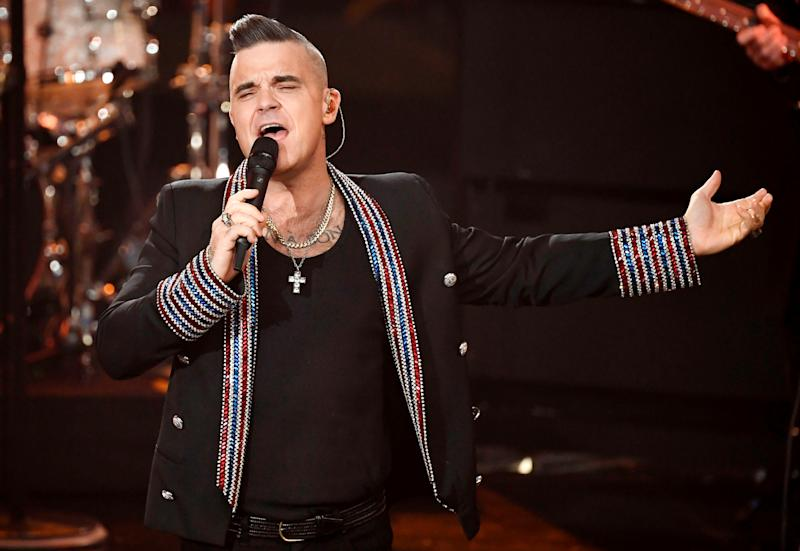 """Singer Robbie Williams performs during the charity gala """"Ein Herz fuer Kinder"""" (a heart for children) in Berlin, Germany, Saturday, December 7, 2019. Picture taken December 7, 2019. Jens Meyer/Pool via REUTERS"""