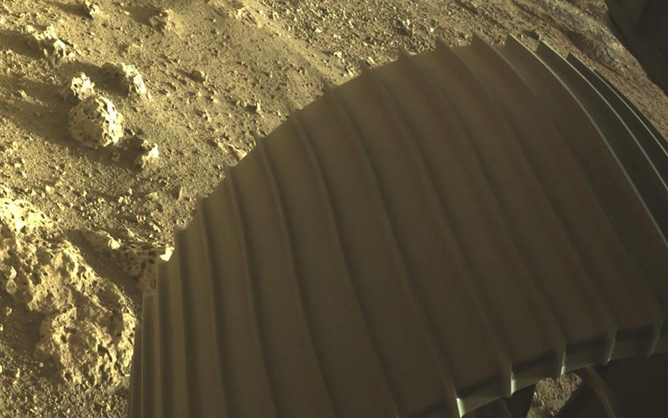 Yellow-ish rocks beneath the rover's front wheel - REUTERS