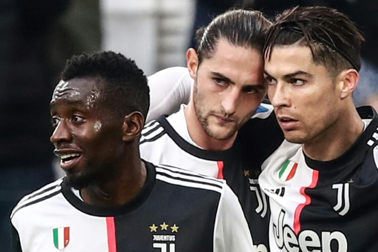 Cristiano Ronaldo (R) 'honoured' Blaise Matuidi (L) by passing him the captain's armband during Juventus'3-1 win over Udinese