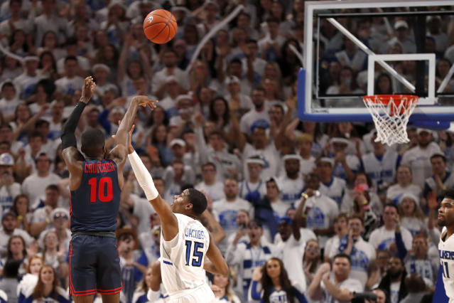 Dayton's Jalen Crutcher (10) makes a basket over Saint Louis' Demarius Jacobs (15) with less than a second left in overtime in an NCAA college basketball game Friday, Jan. 17, 2020, in St. Louis. Dayton won 78-76. (AP Photo/Jeff Roberson)
