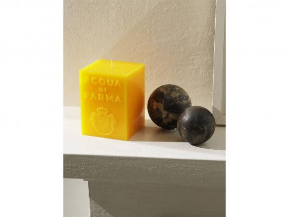 This chunky fragranced candle is an eye-catching addition to any mantelpiece (John Lewis and Partners)