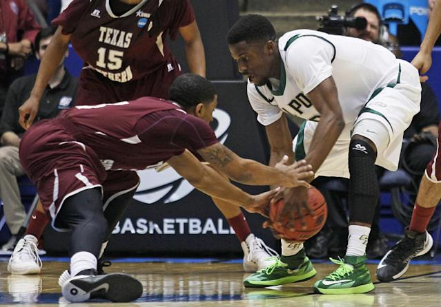 Texas Southern guard Madarious Gibbs, left, and Cal Poly guard Dave Nwaba chase a loose ball in the first half of a first-round game of the NCAA college basketball tournament on Wednesday, March 19, 2014, in Dayton, Ohio. (AP Photo/Skip Peterson)